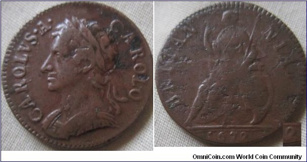 1672 farthing, VF with planchet flaws, and struck with a worn die.. the loop on the 2 is joined to the bottom of the 2 also.