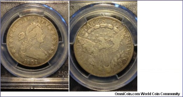 A very scarce date, this one is an O-101 R.3 graded F-12 by PCGS