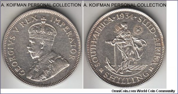 KM-17.3, 1934 South Africa (Dominion) shilling; silver, reeded edge; very fine but cleaned and few scratches.
