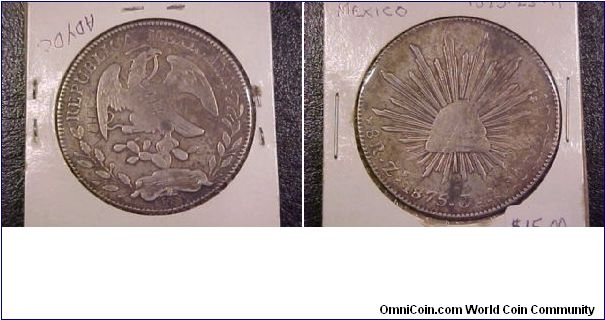 1875 Zs 9-reales with some graffiti on the obverse.